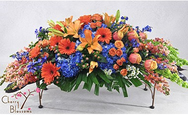 Orange & Blue Casket Spray-Half Cover Shown Avail in Full Cover