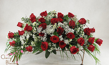 Red Rose Casket Spray-Half Cover Shown Avail in Full Cover<br> Also Available in Pink or White